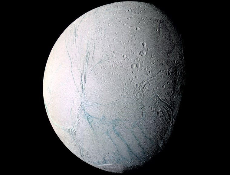 "An enhanced-color image of Enceladus, based on data from the Cassini spacecraft, highlights dark ""tiger stripes"" in the south polar region. Those stripes are actually fissures that appear to be the source of the Saturnian moon's geysers."