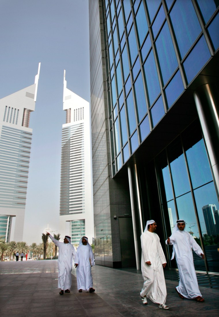 Employees walk in the Dubai International Financial Center on the day of its opening ceremony last fall. The rejection of a planned acquisition of U.S. port properties is a setback for the emirate's ambitious business plans.