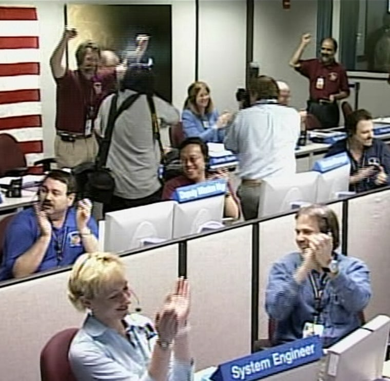 Controllers at NASA's Jet Propulsion Laboratory in Pasadena, Calif., cheer on Friday after hearing that Mars Reconnaissance Orbiter successfully made it into orbit around the Red Planet.