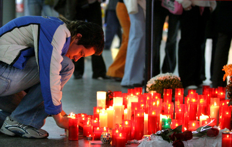 A man pays his respects at a memorial site for the victims of the March 11 train bombings at Atocha station in Madrid