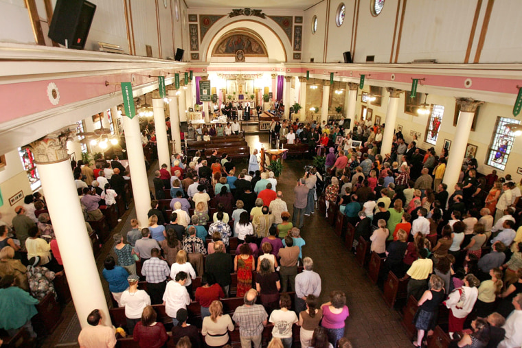 A packed St. Augustine Roman Catholic Church celebrates mass in New Orleans.