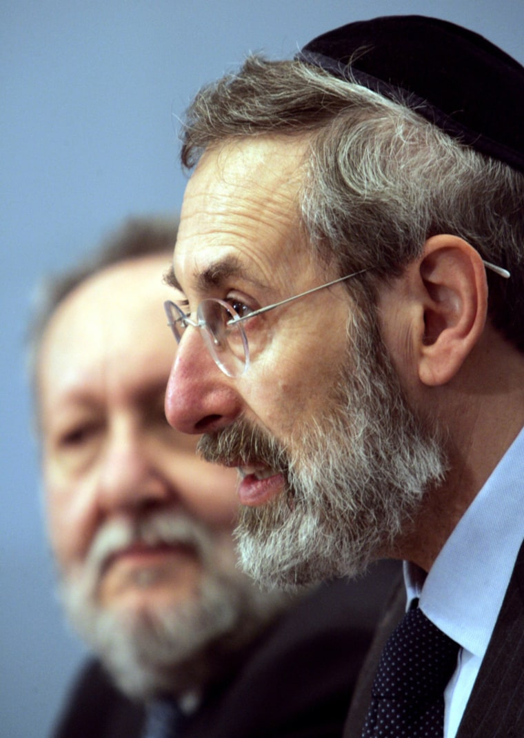 Rome's chief Rabbi Riccardo Di Segni, right, flanked by Mario Scialoja, president of the Muslim World League in Italy, delivers a speech on Monday.