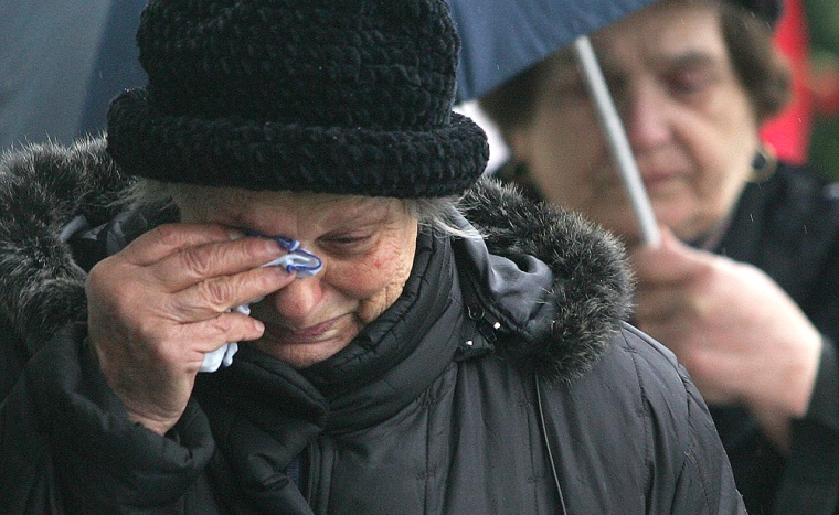 A woman wipes tears after paying tribute to the late Serbian and Yugoslav president Slobodan Milosevic in Belgrade onMonday.