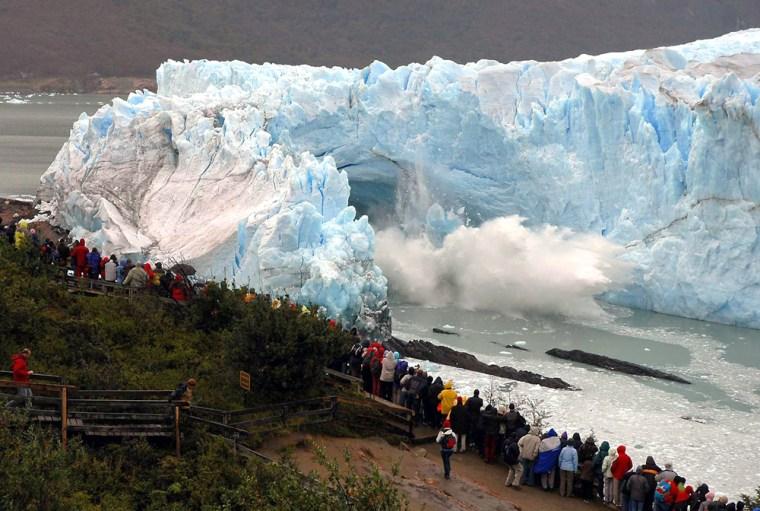 Tourists look at the rupture of the leading edge of the Perito Moreno glacier in Argentina