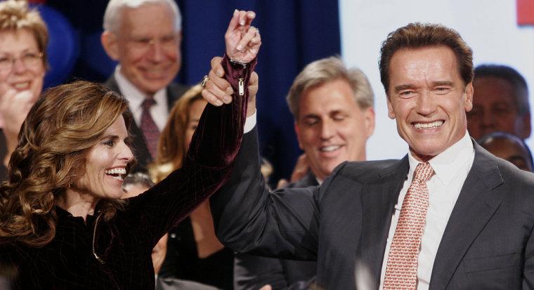 Governor Arnold Schwarzenegger holds up