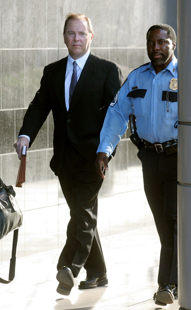 Former Enron CEO Skilling is escorted to Federal courthouse in Houston