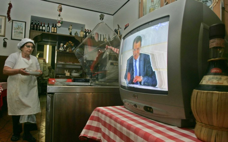 Television screen in Rome restaurant shows Italy's opposition leader Prodi in debate with PM Berlusconi