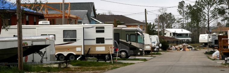 FEMA trailers and campers line Pontiac Roadin Kiln, Miss. The trailers stand on the lots of heavily flood-damaged homes, built on stilts along the banks of the Jourdan River.