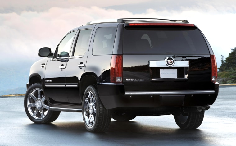 The 2007 Cadillac Escalade is shown. Automakers like GM are offering generous rebates on brands like the Cadillac this spring, but consumers may opt forlease deals, analysts say.
