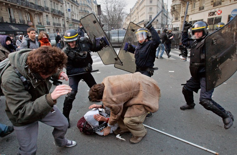 Protesters clash thursday with riot police officers in Paris after a student protest against the First Job Contract, known as CPE, a new labor law. The government tried to maintain a united front for this pivotal test of the country's future direction.
