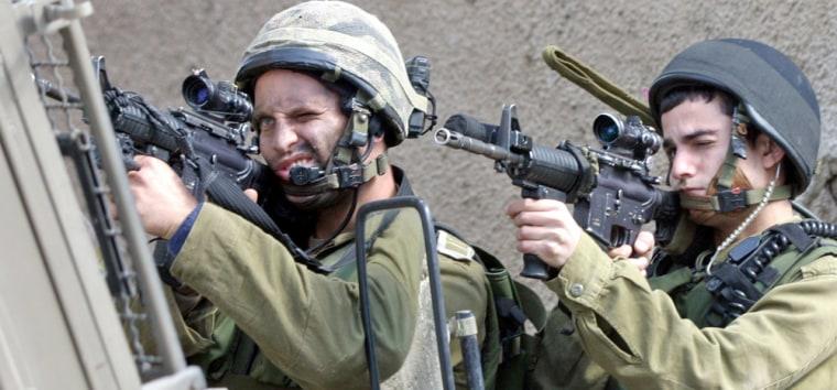 Israeli soldiers aim their rifles in Jenin