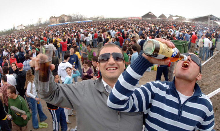 Teenagers drink during macrobotellon drinking session in Granada southern Spain