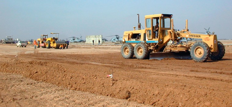 Turkish contractors grade a parking ramp for the U.S. aircraft's Balad air base, 40 miles north of Baghdad, earlier this month.