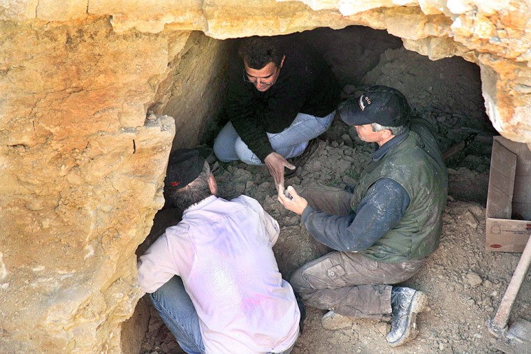 People work in the ancient tomb in Kouklia village near the coastal town of Paphos, Cyprus, where thewhite-stone sarcophagus was found.