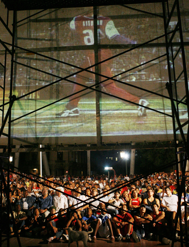Cubans watch the World Baseball Classic final game between Cuba and Japan in Havana on Monday night.