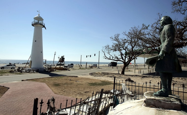A statue of explorer Pierre LeMoyne d'Iberville looks out at the lighthouse along U.S. Highway 90 in Biloxi, Miss. The big question: When will the tourists come back?