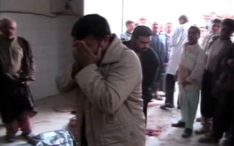 This image taken from a videotape made by a journalism student and obtained by Time magazine shows a scene in what appears to be a morgue following an alleged fatal raid by U.S. forces Nov. 19, 2005, in Haditha, Iraq.