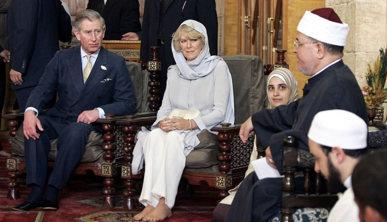 Britain's Prince Charles and his wife, Camilla, listen to a Koran lesson in the Al-Azhar Mosque in Cairo on Tuesday during a five-day visit to Egypt.