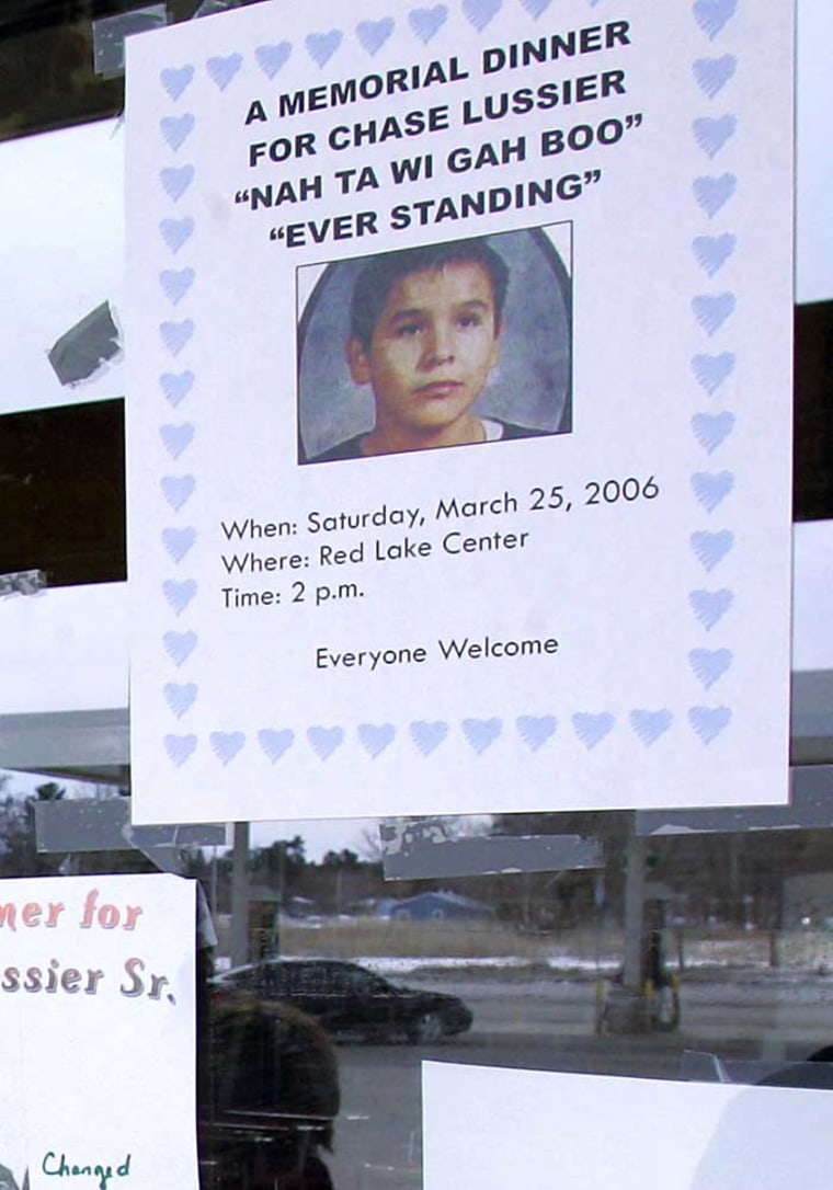 A flyer posted at a Red Lake, Minn., grocery store on Monday announces a memorial dinner for Chase Lussier, one of five students shot and killed by a fellow student last March 21 at Red Lake High School.