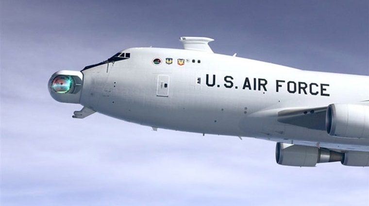 The Boeing-led Airborne Laser team exposes the Airborne Laser's conformal window during a test flight.Such anexposure is necessary for the weapon system to complete its mission of shooting down a ballistic missile during the boost phase of flight.