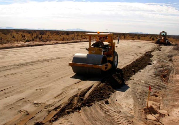 A bulldozer is at work at New Mexico's spaceport site, preparing the ground for an upcoming suborbital rocket flight.