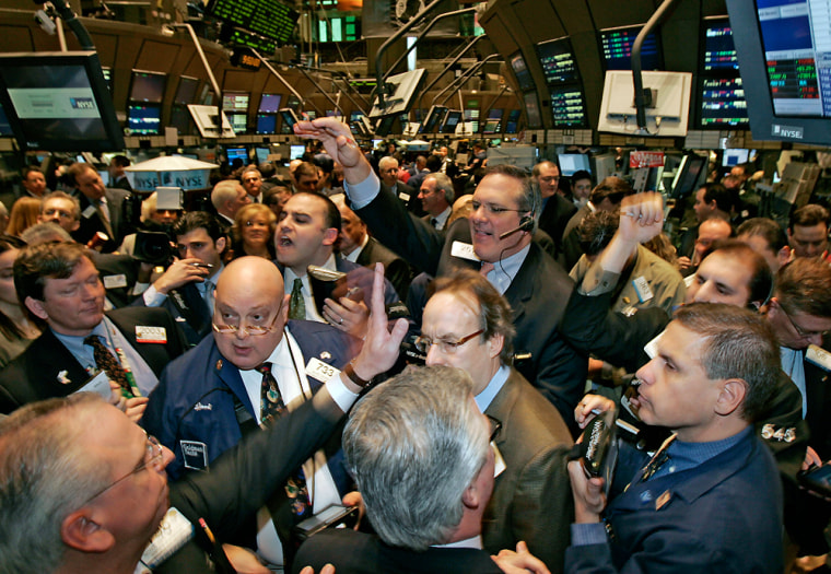 Traders crowd the post on the floor of the New York Stock Exchange as Canadian coffee and doughnut chain Tim Hortons Inc. has its initial public offering Friday.