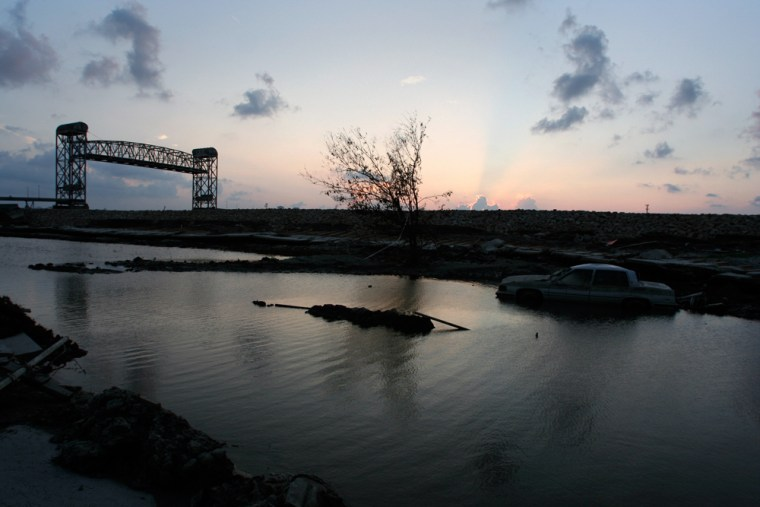 The broken Industrial Levee located near the N. Claiborne drawbridge in New Orleans' Ninth Ward is seen at sunset on Oct. 3, 2005.