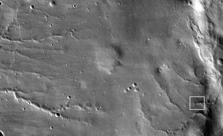 This view shows the ground covered in the first image of Mars taken by the HiRISE camera on NASA's Mars Reconnaissance Orbiter. The image covers an area 49.8 kilometers (30.9 miles) wide and 23.6 kilometers (11.7 miles) high, and is a mosaic of exposures taken from an altitude of 2,489 kilometers (1,547 miles). The white box indicateswhere the detailed image, seen below, is taken from.