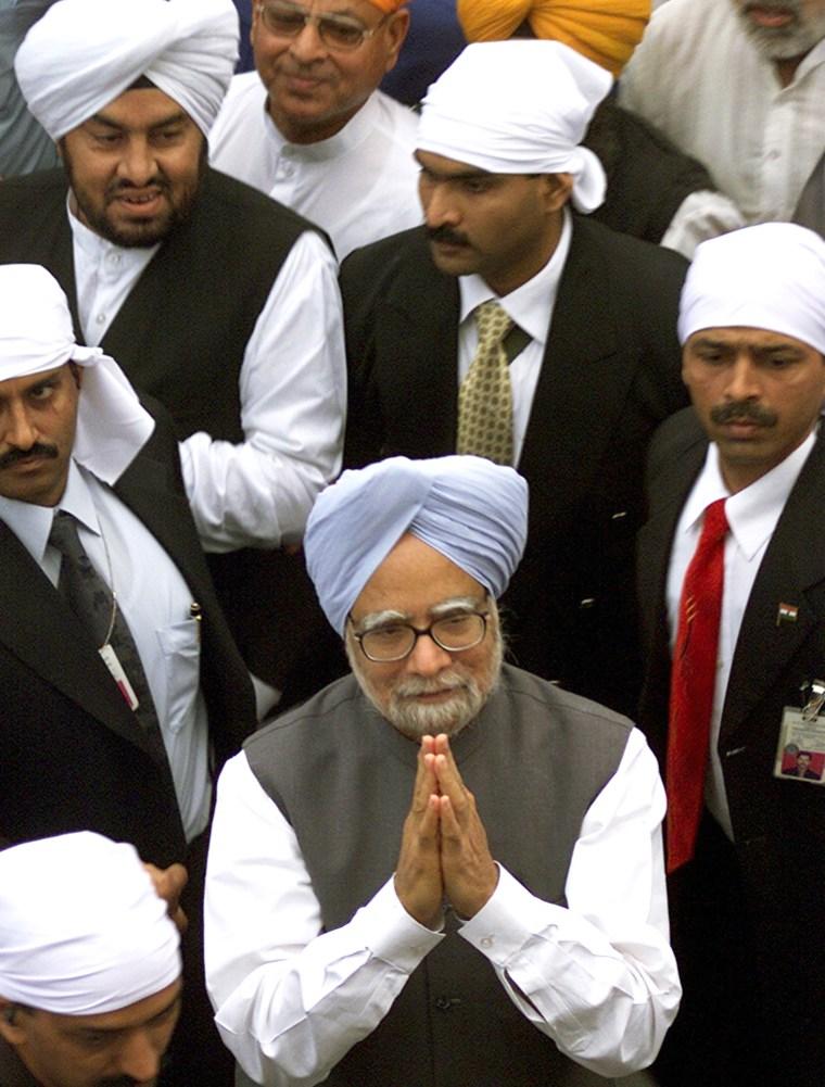 Indian Prime Minister Singh gestures after visiting holy Sikh shrine in Amritsar