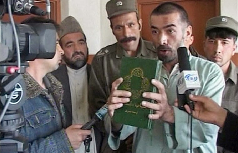 Frame grab shows Rahman holding a translated version of Bible in Kabul court