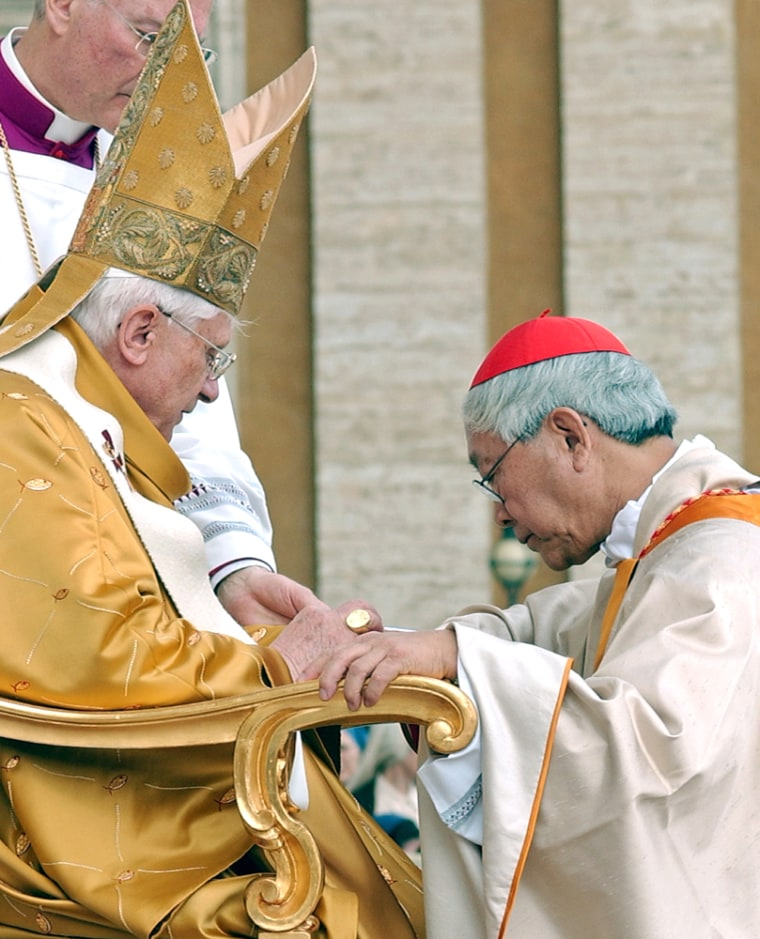 Newly elevated Cardinal Zen of Hong Kong receives his ring from Pope Benedict XVI at the Vatican