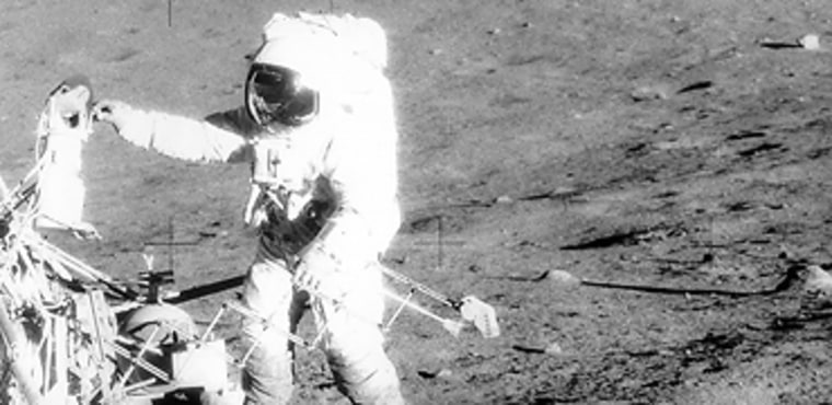 During the Apollo 12 mission in 1969,commander Pete Conrad retrieves equipment from the Surveyor 3 probe, which landed on the moon three years earlier. This picture, taken byastronaut Alan Bean, shows Apollo 12's lunar module in the far distance. Future lunar missions may locate similar leftovers, for scientific as well as historical purposes.