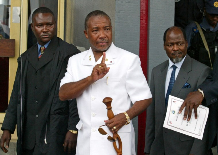 File photo of Liberia's former President Charles Taylor leaving for Nigeria