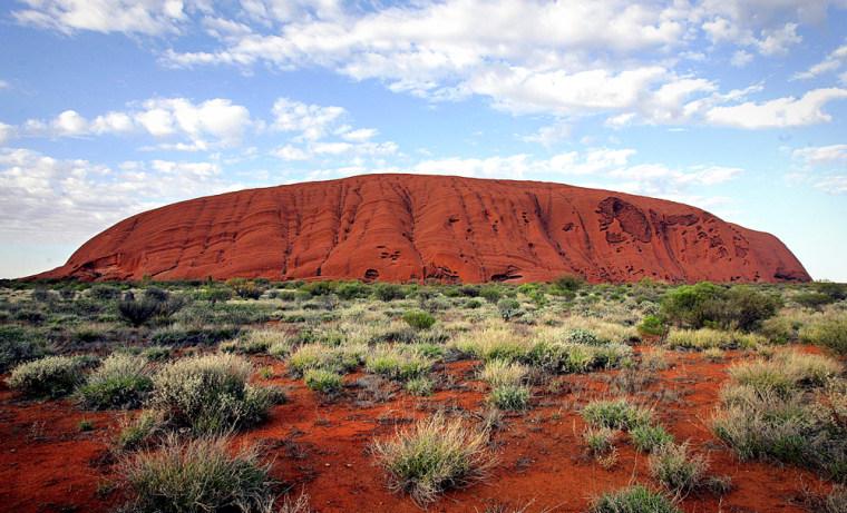 The monolith of Uluru (Ayers Rock) rises