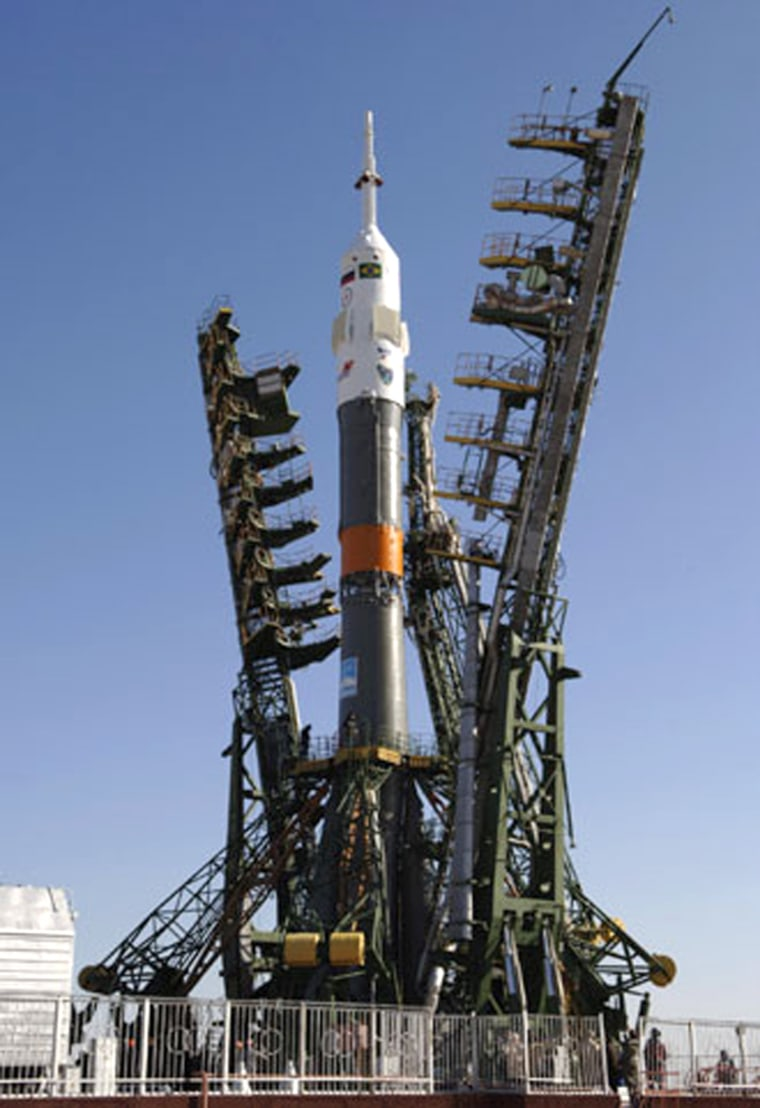 ASoyuz rocket stands ready at the launch pad at Russia's Baikonur Cosmodrome in Kazakhstan, awaiting final preparations for launch on Wednesday. The rocket is to send three astronauts to the international space station.