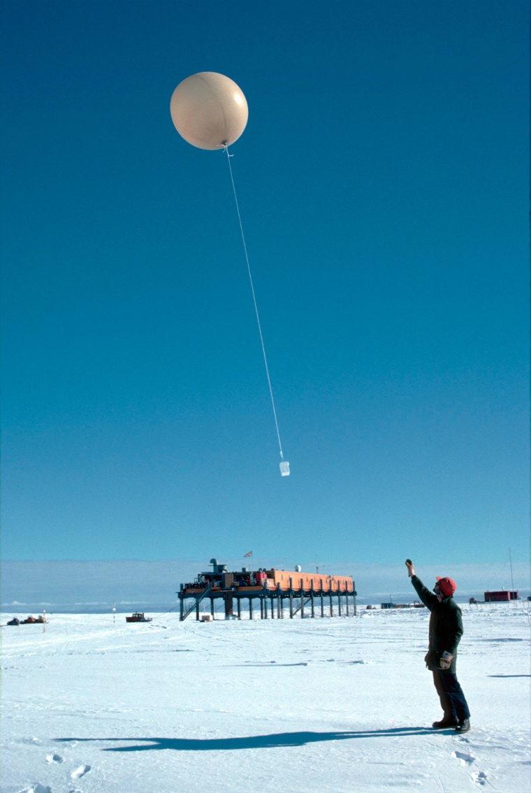 A researcher launches a weather balloon from theBritish Antarctic Survey's Halley Research Station.