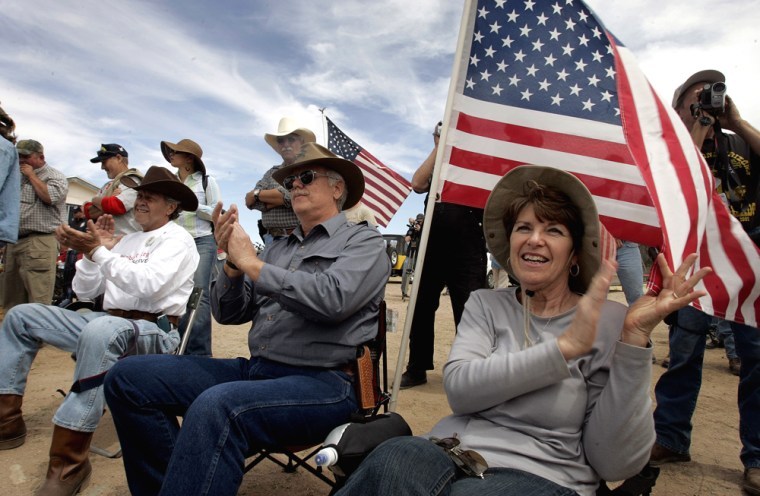 Carol Withers, right, sits beside her husband Ross Withers during a Minuteman Project rally near Three Points, Ariz.,onSaturday