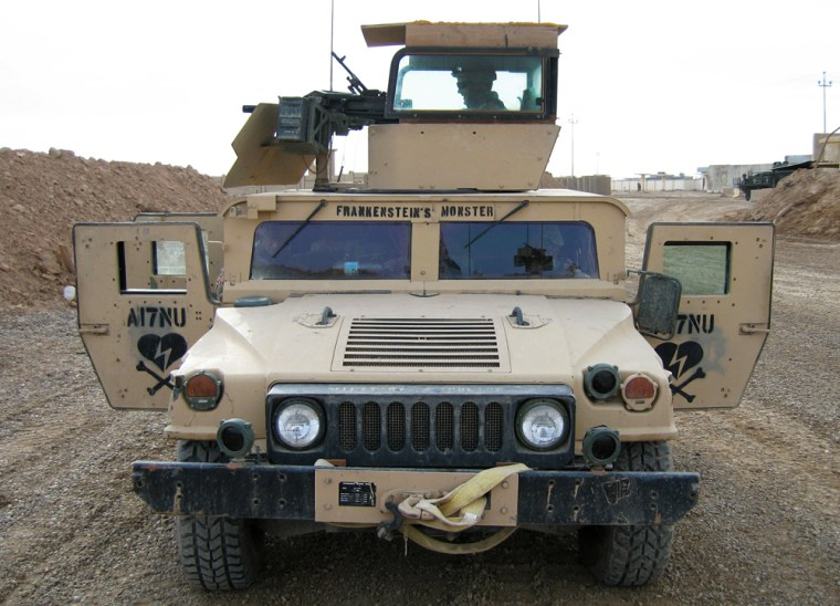 """Spc. Anthony Jorgensen, 24, of Philadelphia mans the turret of a Humvee called Frankenstein's Monster that has been modified with """"Pope Glass"""" around the turret."""