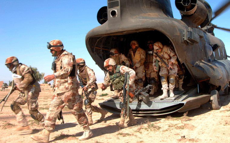Iraqi army soldiers of the 4th Iraqi Army Division exit a U.S. CH-47 Chinook helicopter as partof Operation Swarmer in Samarra, Iraq, in March.