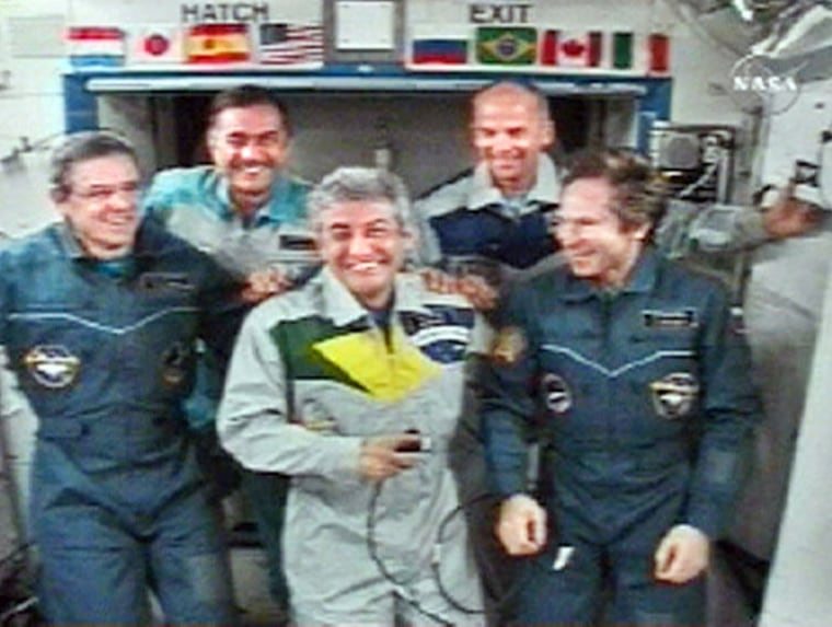 Video grab shows Brazilian astronaut Marcos Pontes smiling during news conference from International Space Station