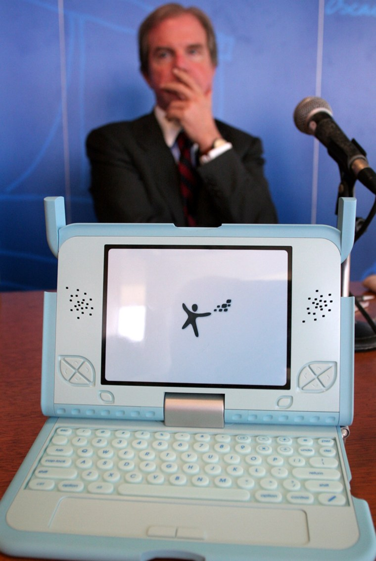 """""""When you have both Intel and Microsoft on your case, you know you're doing something right,"""" MIT professor Nicholas Negroponte toldopen-source fans Tuesday. He is seen here in a photo from March with a prototype of his$100 laptop."""