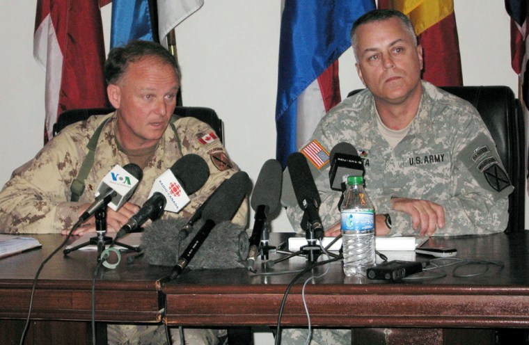 Canadian Brig. Gen. David Fraser, left, and U.S. Brig. Gen. Anthony Tata answer questions from reporters Tuesday,in Kandahar, Afghanistan, after announcing an investigation into two possible friendly fire deaths last week.