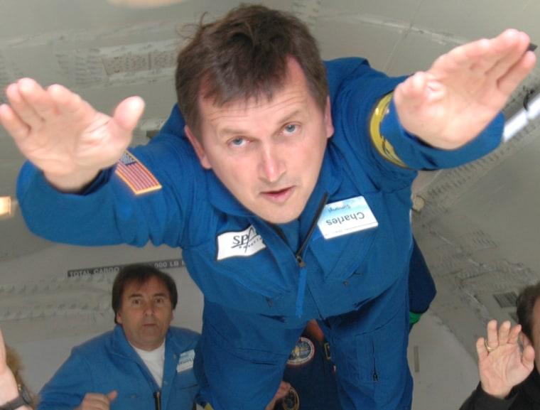 """Software billionaire Charles Simonyi, shown here doing a """"Superman"""" act during a zero-gravity airplane flight, has signed up for a multimillion-dollar trip to the international space station."""