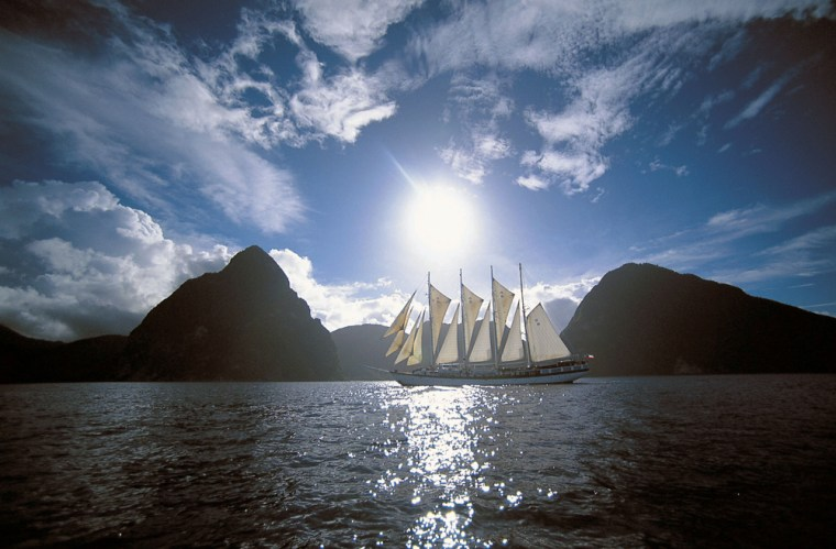 The Windjammer ship Polynesia sailing in between the Twin Pitons of the Caribbean island of St. Lucia.