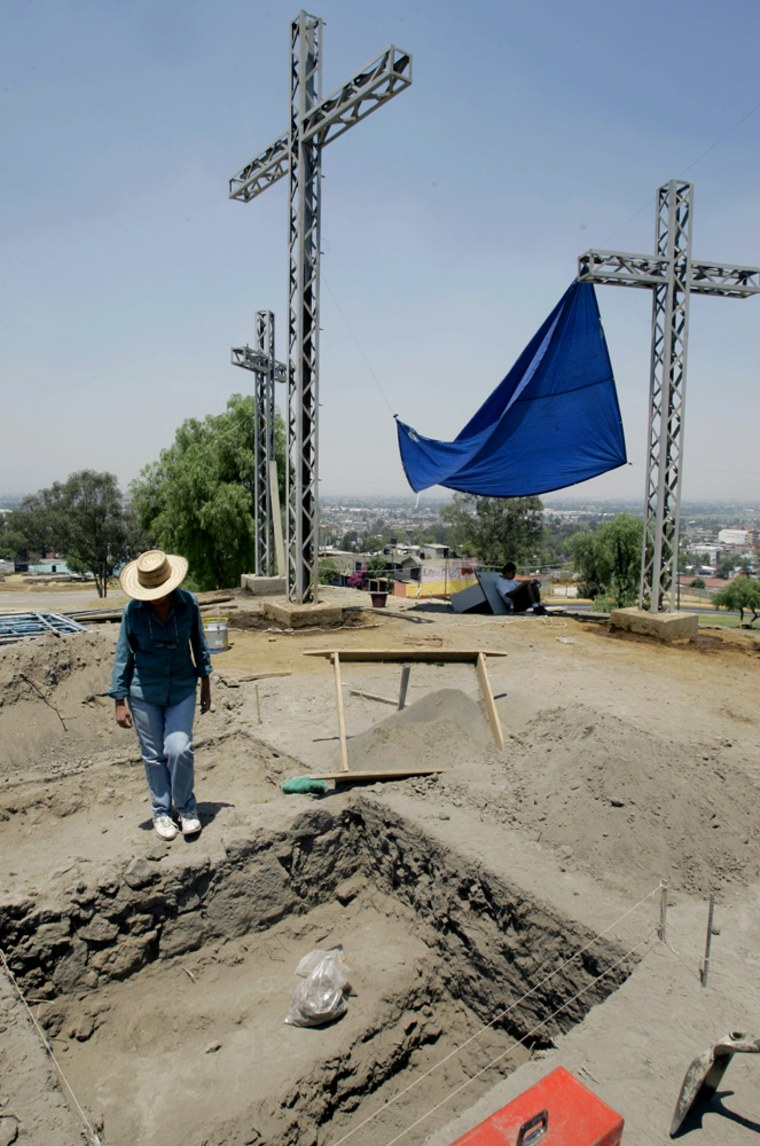 Archaeologist Maria Flores works on the excavation of a massive 6th-century Indian pyramidin Mexico City, Mexico, on Wednesday. A centuries-old ritual in which the crucifixion of Christ is re-enacted draws as many as a million spectators to the same site each year.