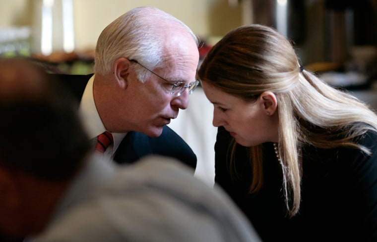 Rep. Christopher Shays talks to a member of his staff during a breakfast meeting last monthon clean energy.