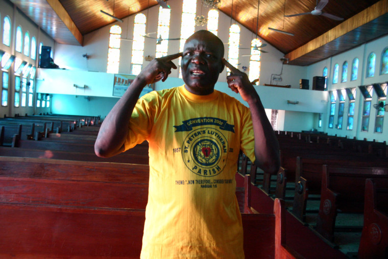 Pastor Thomas Z. Paye is seen in St. Peter's Lutheran Church, site of an infamous 1990 massacre but now getting repaired, like much of Monrovia, Liberia.