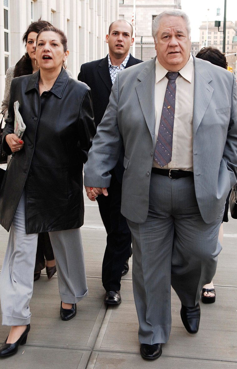 Former New York City police detective Louis Eppolito enters Brooklyn federal court with his wife, Fran, on Wednesday in New York.