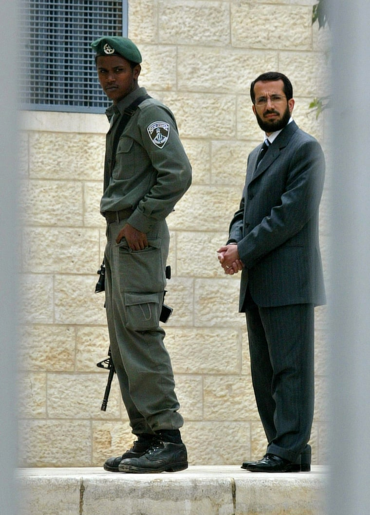 Khaled Abu Arafa, minister of Jerusalem affairs in the Hamas government, right, has been detained by Israel.