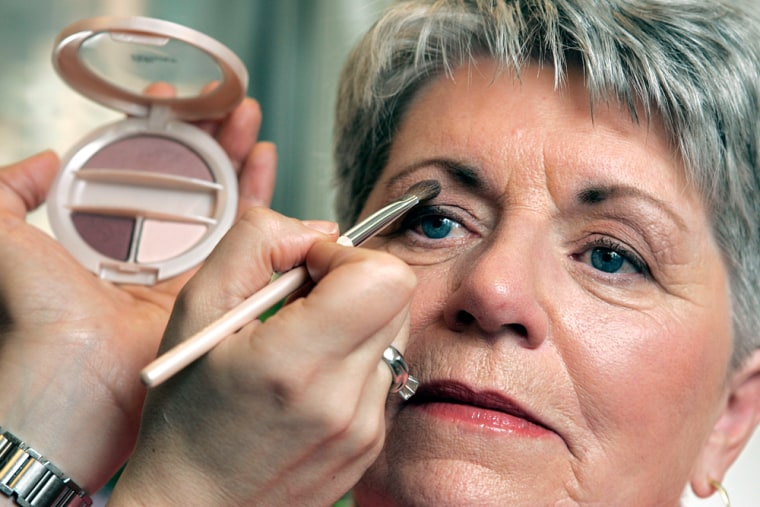 Kathleen Maguire, 66, of Mt. Laurel, N.J., has Vital Radiance Soft Dimension Powder Shadow applied at Revlon headquarters in New York.